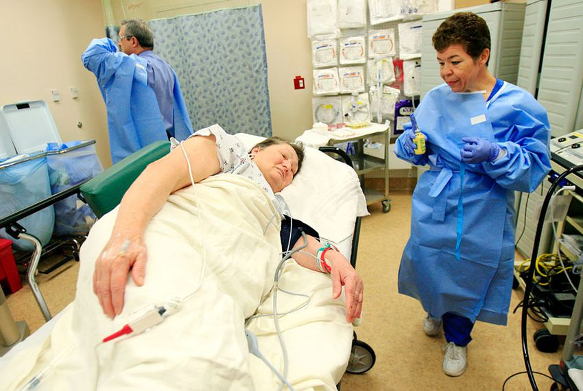 Endoscopy tech Dora Facturan, right, prepares Maria Perez, 65, for a colonoscopy exam from Dr. Carlos Cardenas, back left, on December 8, 2010 at the Doctor's Hospital at Renaissance in Edinburg. South Texans lead some of the longest lives in the state.