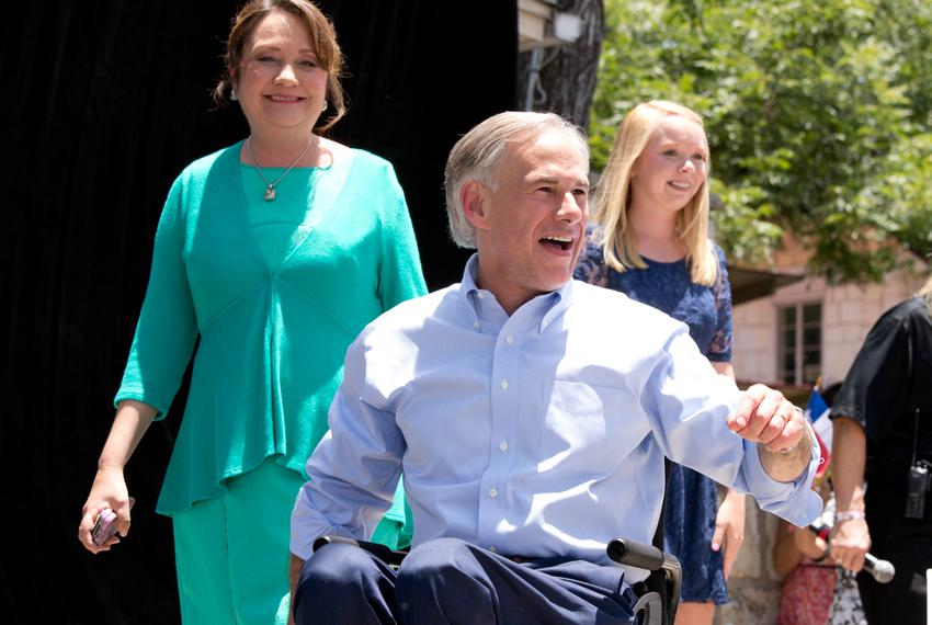 Texas Attorney General Greg Abbott on stage with his wife Cecilia and daughter Audrey moments before announcing his gubern...