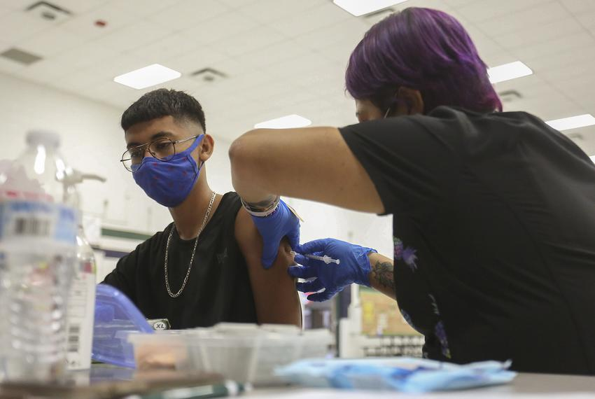 Angel Castro, 16, received his first shot of the Pfizer vaccine at William D. Slider Middle School in El Paso on July 22, 20…