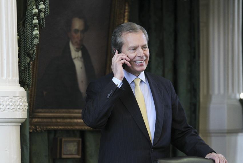 Lt. Governor David Dewhurst speaks on a cellphone at the dais during the Senate session on April 6, 2011.