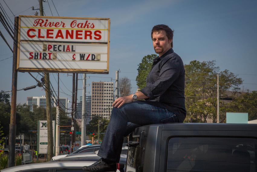 Trey Melcher in front of his family's shopping center, where River Oaks Cleaners is a tenant. The Melchers feel they've been…