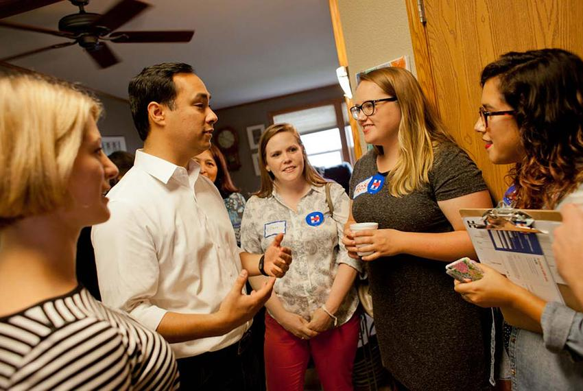 U.S. Rep. Joaquin Castro, D-San Antonio, talks to staffers from Hillary Clinton's Iowa campaign at a morning campaign event …