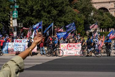 """Supporters of President Donald Trump gather in front of the state Capitol Building for a """"Stop the Steal"""" rally after Joe Biden was declared the winner of the 2020 presidential election. Nov. 7, 2020."""