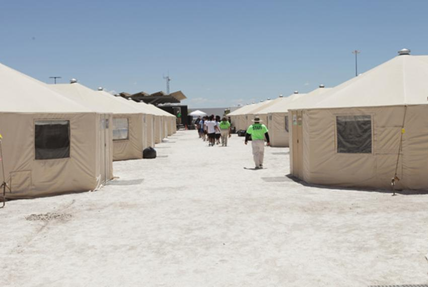 Staff accompany children inside the tent city at Tornillo, near El Paso, where undocumented immigrant minors are being held …
