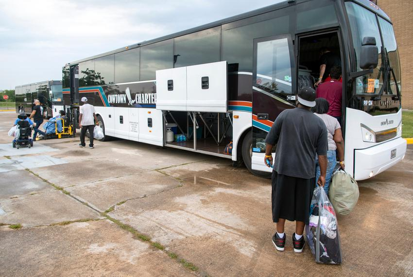 Port Arthur residents board buses to evacuate the area before Hurricane Laura strikes the Gulf Coast near Texas and Louisi...