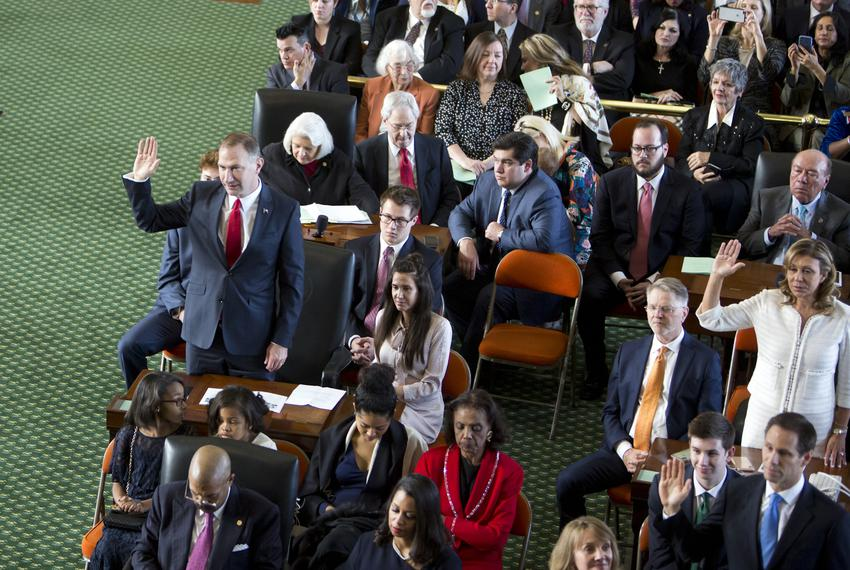 State Sens. Charles Schwertner, R-Georgetown (standing, left), and Joan Huffman, R-Houston (standing, right) take the oath o…