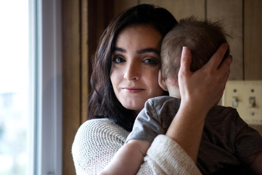 Sydney Sigler, 26, holds her daughter in her home in Robinson, Texas on Feb. 26, 2019.