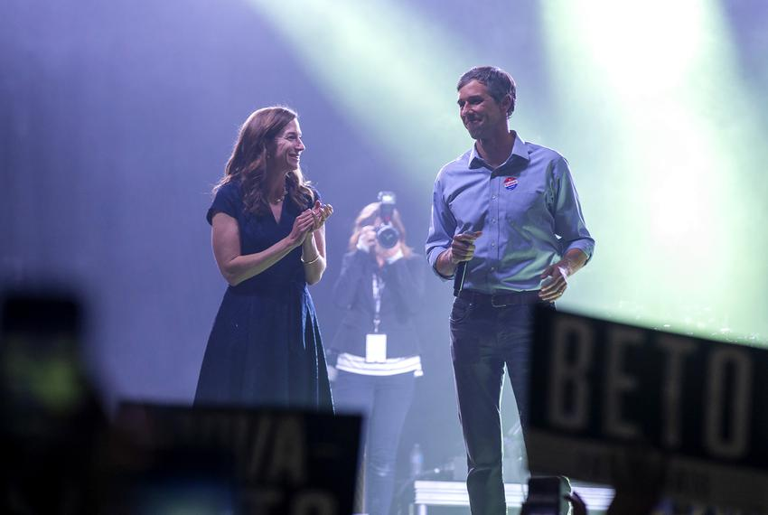 Beto O'Rourke and his wife Amy Sanders O'Rourke walk onto the stage to address his supporters after losing to Ted Cruz in ...