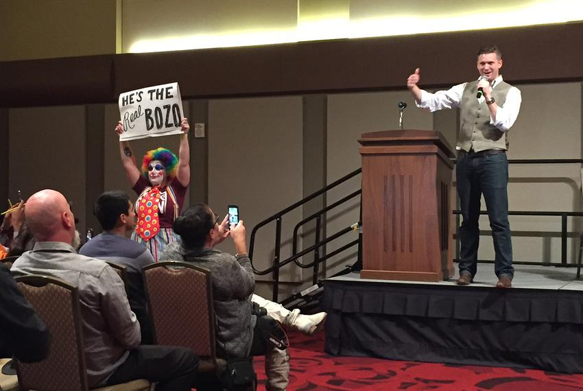 White nationalist Richard Spencer speaks while protester holds sign at Texas A&M campus in College Station on December 6, 20…
