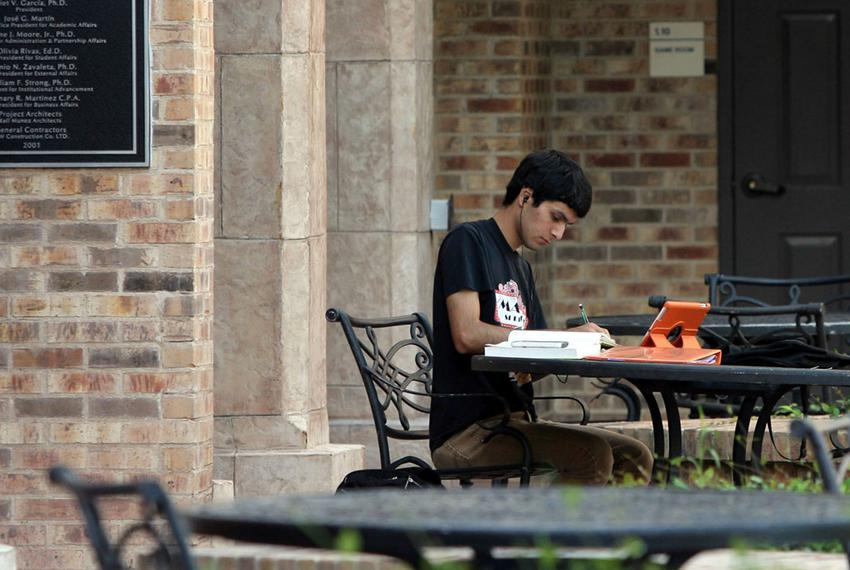 A student works on the campus of what was then the University of Texas at Brownsville. The university is now part of the Uni…