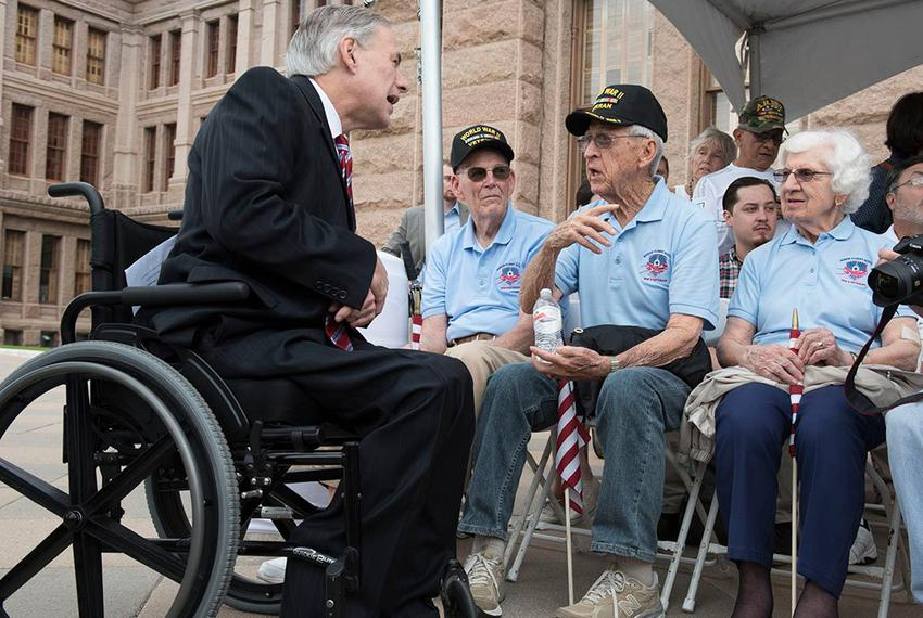 Gov. Greg Abbott greets WWII veterans Gene Myers (Navy) and Eugene McClarq (Air Force) at the Capitol Veterans Day ceremony …