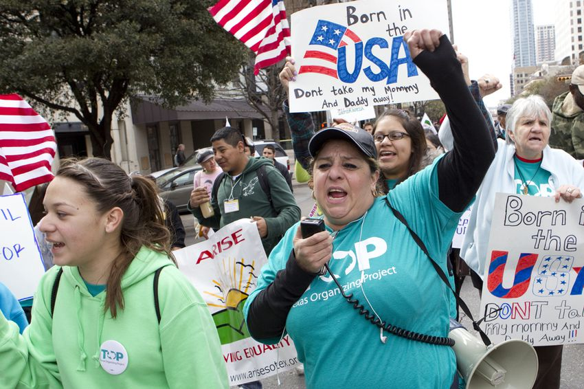 Large group for immigration reform, walks up Congress Ave. towards the Texas Capitol on February 22nd, 2013