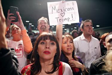 Fans watch Donald Trump speak at his rally at the Forth Worth Convention Center on Feb. 26, 2016.