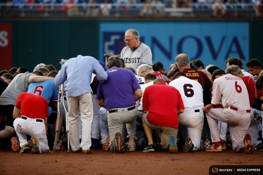 Patrick Conroy, Chaplain of the House of Representatives, leads Democrats and Republicans in prayer before they face off in the annual Congressional Baseball Game at Nationals Park in Washington D.C. on June 15, 2017.