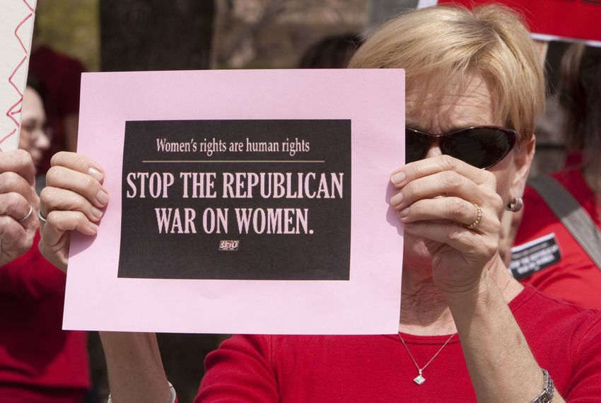 Woman at Texas Capitol protests Republican lawmakers decision to exclude Planned Parenthood from the Women's Health Program