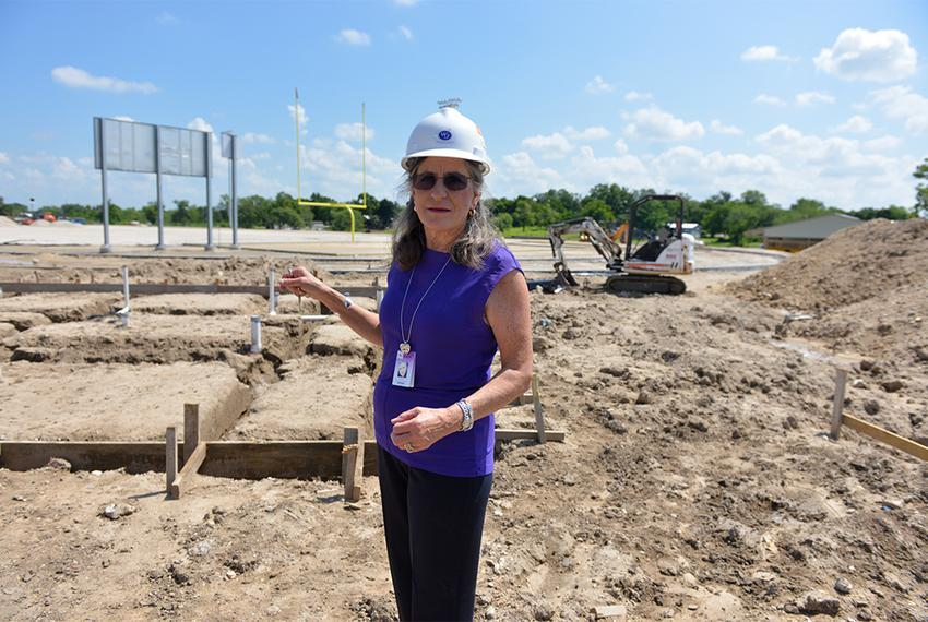 Pam Seipp, interim superintendent of Runge schools, looks over ongoing construction of a new football stadium. In May 2014, …