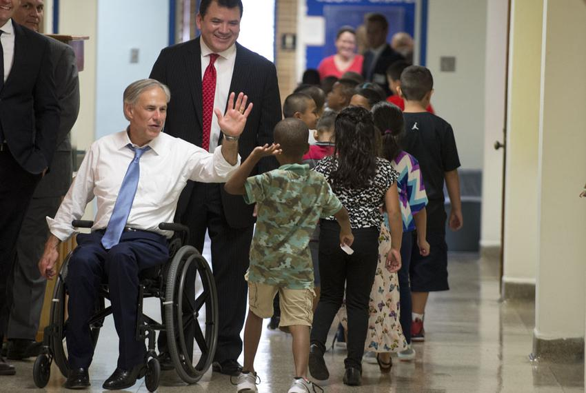 Gov. Greg Abbott greets Zavala Elementary schoolchildren in the hallway of the east Austin school on the first day of classe…