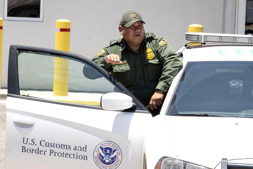 "U.S. Border Patrol and McAllen police guard outside the immigrant detention center known as ""Ursula"" on June 23, 2018."