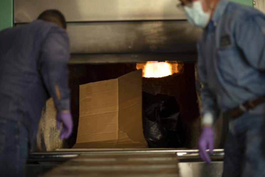 A body inside of an incinerator at the crematorium at Val Verde Memorial Gardens. July 17, 2020.