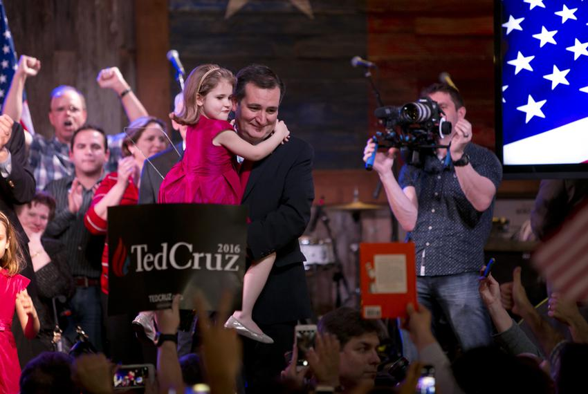 Sen. Ted Cruz carries his youngest daughter after winning the Texas GOP primary on March 1, 2016