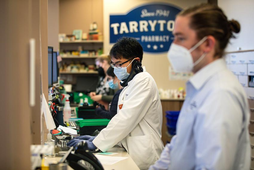 Staff members work in Tarrytown pharmacy in Austin on Jan. 14, 2021.
