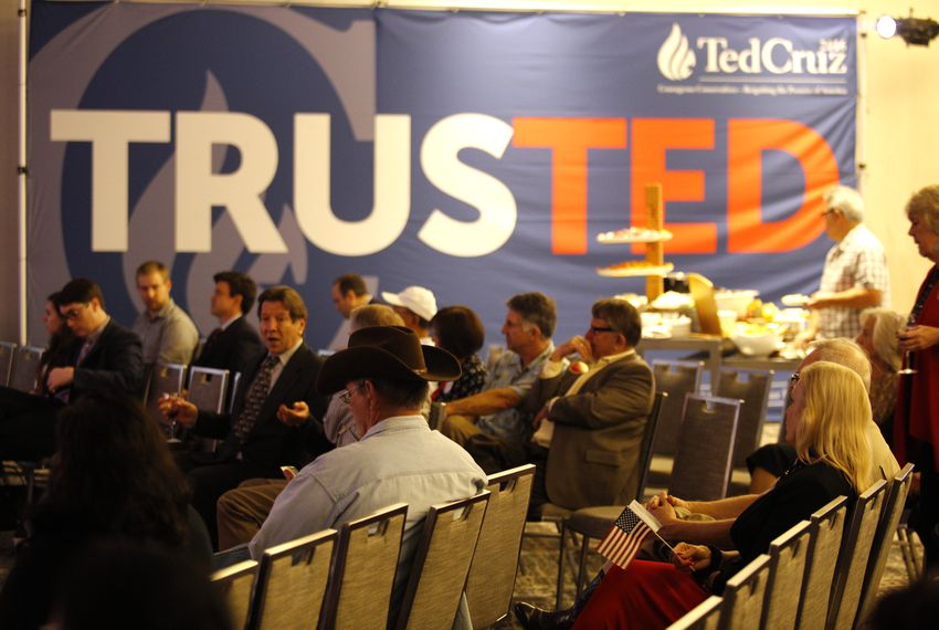 Supporters of Ted Cruz watch as results come in at his election night party Tuesday in Houston. Five states are holding their presidential nominating contests Tuesday.