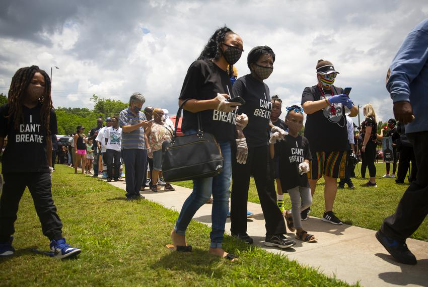 Families walk through lines during the public memorial service at the Fountain of Praise Church in Houston on June 8, 2020.