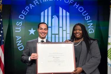 Senior Adviser Maya Rupert and Housing Secretary Julian Castro.