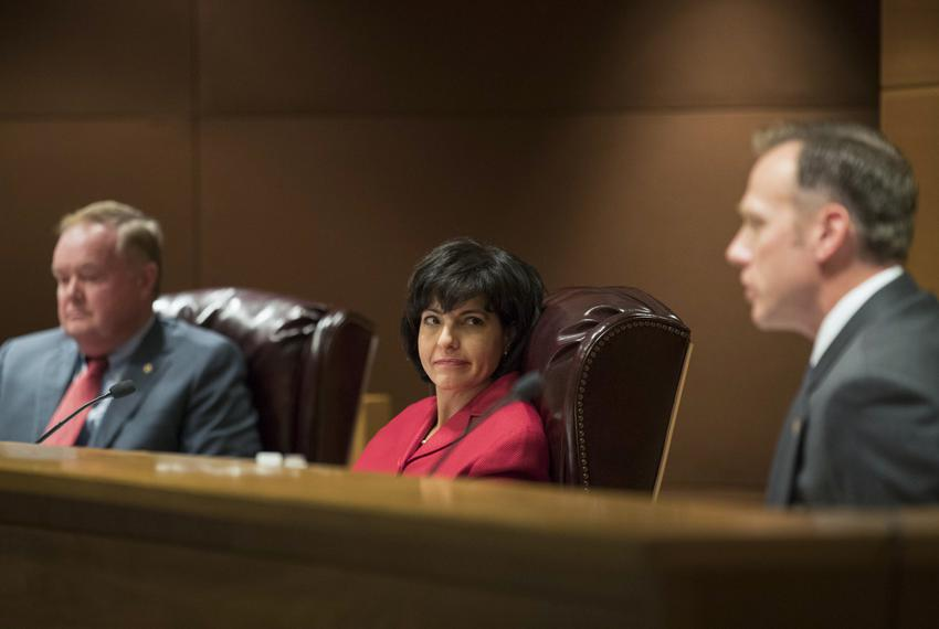At center, Texas Railroad Commissioner Christi Craddick during a hearing at the capitol.