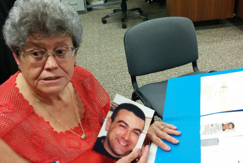 Bonnie D'Amico holds a photograph of her son Nicholas D'Amico, who committed suicide after being honorably discharged from t…
