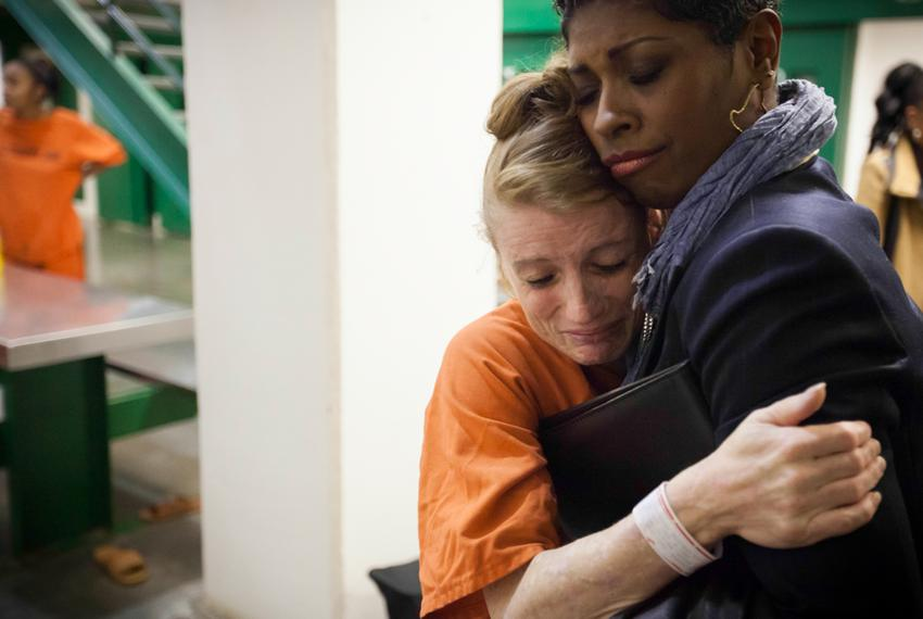 A program manager in the Harris County Jail's Mentoring Moms program hugs a weeping Marilyn Miles, 35. Miles, who had her ei…