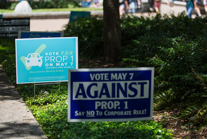 Austin's Prop 1 signs posted along University of Texas at Austin's campus voting center on April 28, 2016.