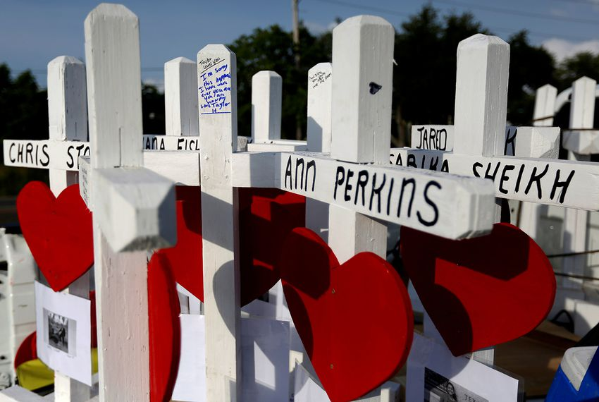 Crosses bear the names of the victims killed in a mass shooting at Santa Fe High School.