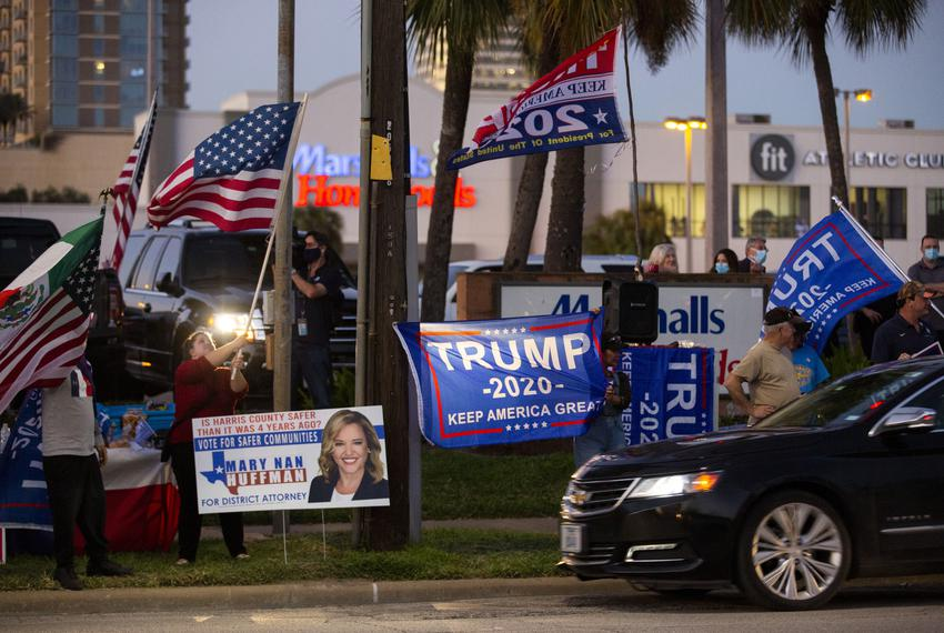 Supporters of President Donald Trump outside of the Metropolitan Multi-Services Center during Election Day in Houston on Nov…