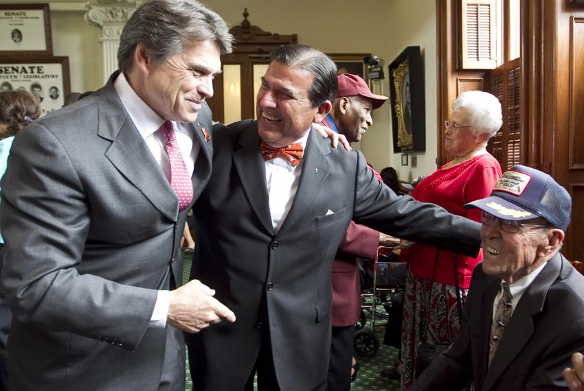 Gov. Perry, along with his father Ray Perry and Sen. Eddie Lucio, D-Brownsville, on Senate floor where World War Two veteran…