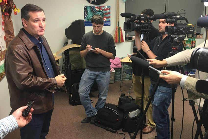 U.S. Sen. Ted Cruz speaks with reporters during an event in Iowa on Nov. 28, 2015.