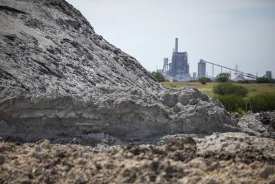 San Miguel Electric Cooperative has piled a mound of coal ash — a byproduct of burning coal that contains toxic heavy metals — on land it leases from the Peeler family. Its 400-megawatt power plant is in the background.