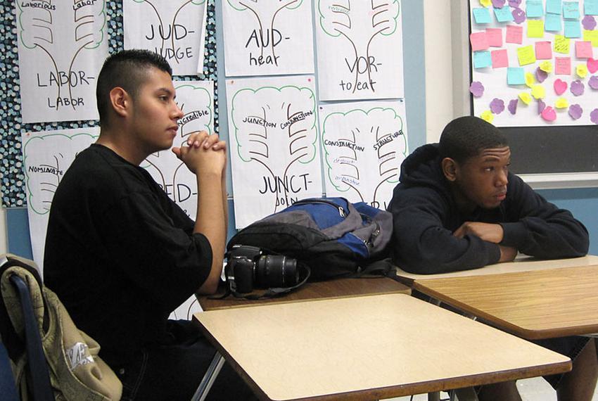 Students Arturo Garcia and Chris Conway listen to a U.S. Department of Education representative describe a grant program tar…