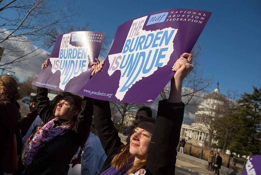 Lauren Baker (right) of Plano and Mary Baumgard of Minnesota held signs in front of the U.S. Supreme Court March 2, 2016, as the court arguments in a case on a Texas abortion law.