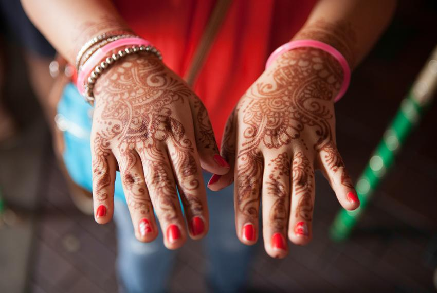 Jaanvi Sabharwal's hands were decorated with henna for an Indian wedding she attended in Sugar Land. She was visiting from T…