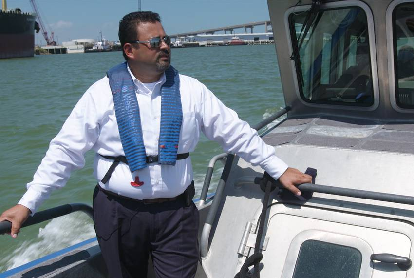 Eddie Martinez, the Port of Corpus Christi's business development representative, cruises in a boat along the ship channel on June 6, 2018. Crude oil export...