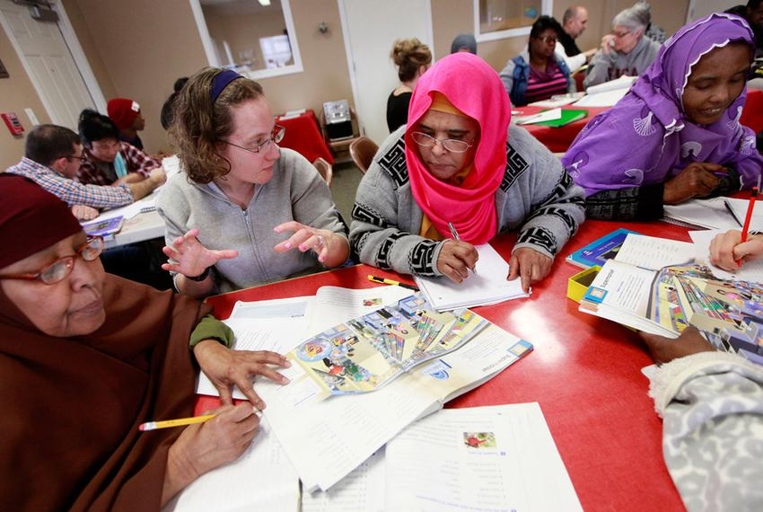 Volunteer Jennifer Butler, second from left, works with Somali immigrants Saharlo Adlle, from left, Zainab Botnb and Ikyan S…