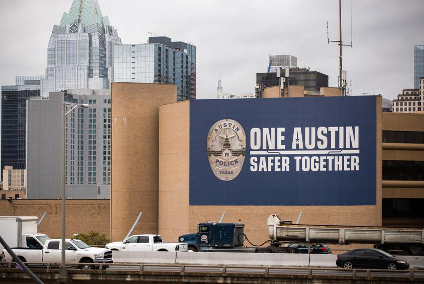 The Austin Police Department building with the Austin skyline in the background on March 22, 2021.