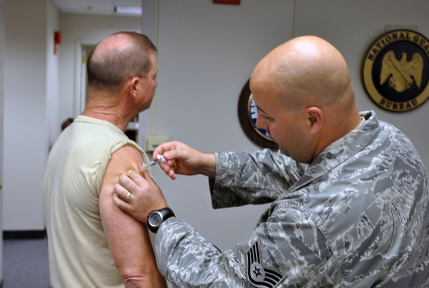 A National Guard soldier receives a seasonal flu shot in Virginia in 2009.