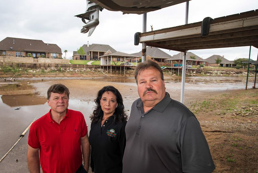 Granbury resident Joe Williams (left) stands with City Council Member Rose Myers and Hood County Commissioner Steve Berry un…