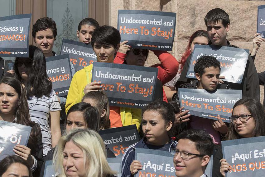 A coalition of immigrant rights groups protest SB 4 at the East steps of the Texas Capitol prior to a committee hearing on t…