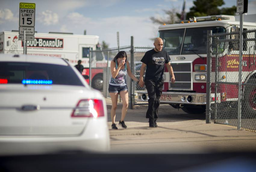 A woman is seen crying after leaving the family reunification center at MaCarthur Elementary, Saturday, August 3, 2019, in...