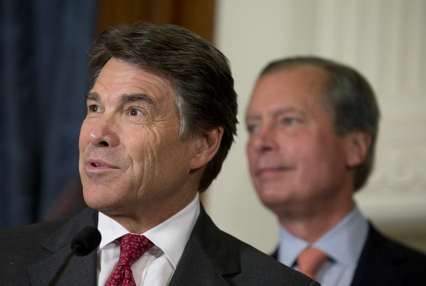 Gov. Rick Perry and Lt. Gov. David Dewhurst answer questions from the media after a series of education bill signings on J...