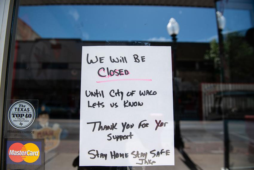 A hand written signs alerts costumers that Jake's Texas Tea House  is closed indefinitely in Waco. March 25, 2020.