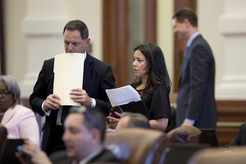 Rep. Rafael Anchia, D-Dallas, speaks to Rep. Victoria Neave, D-Dallas, at the back mic in the Texas House during the debat...
